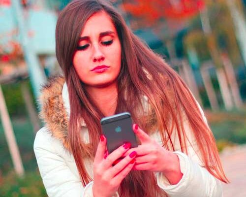 Woman searching on mobile phone in Bridgend